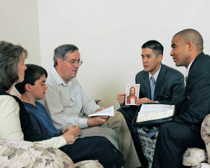 mormon-missionaries-teaching-in-home