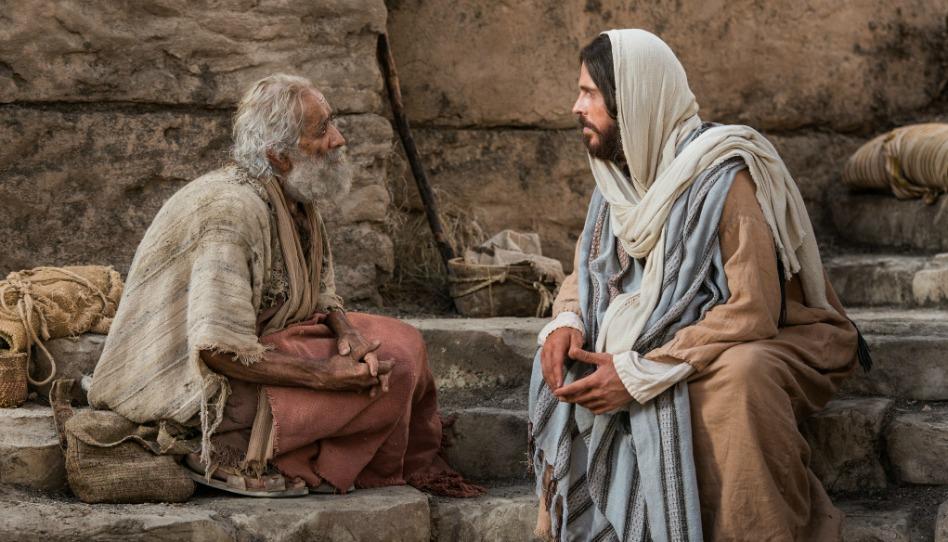 病に苦しむ人と話されるキリスト