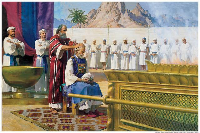 モーセがアロンに油注ぎの儀式をする様子